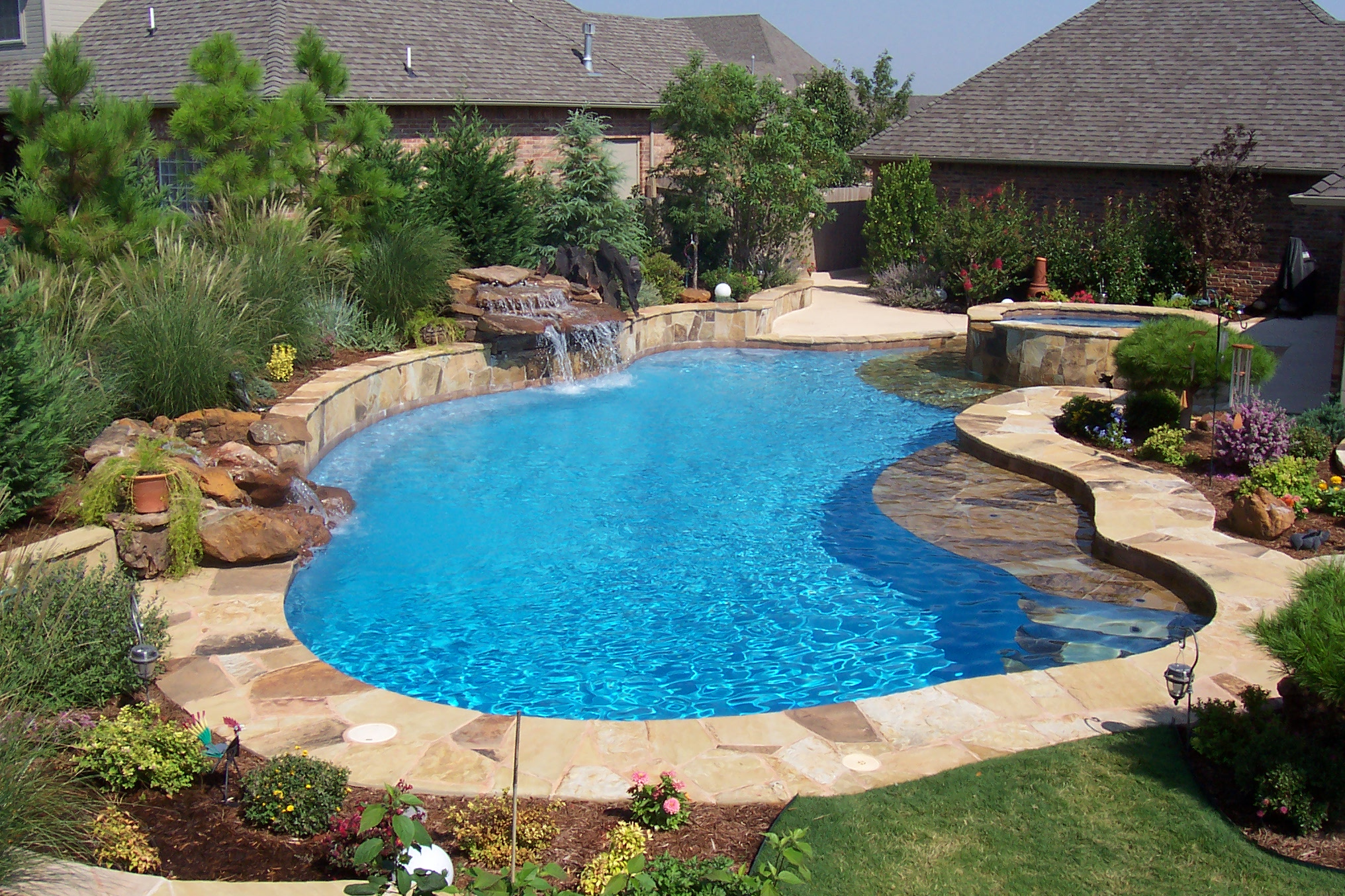 Free form pool designs in okc norman ok blue haven for Fancy swimming pool designs