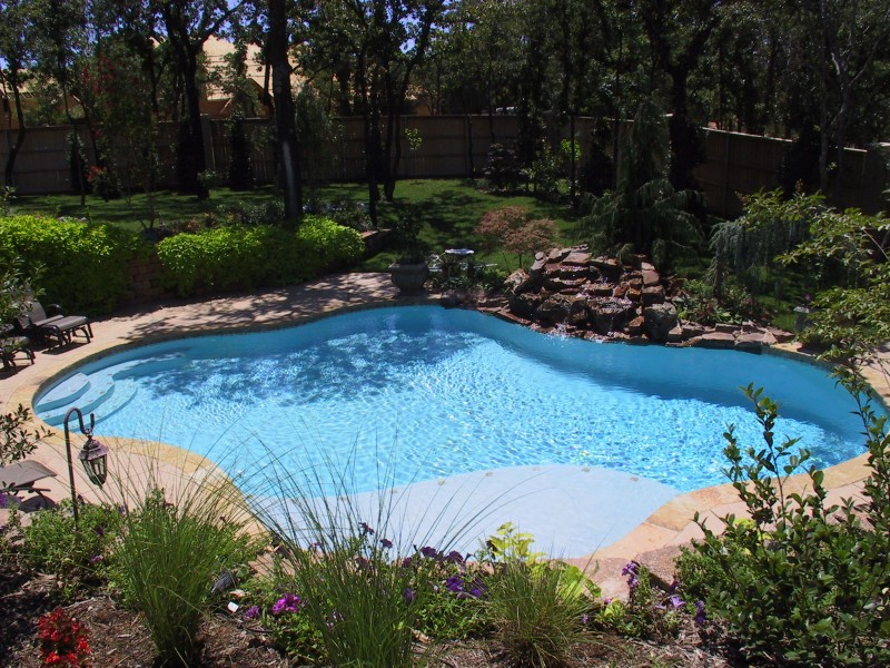 Free form pool designs in okc norman ok blue haven for Above ground pool decks tulsa
