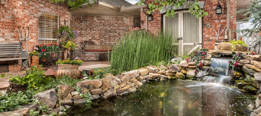 Landscaping with koi pond by Blue Haven Pools